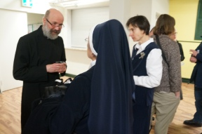 Fr. Kipling Cooper from Annunciation talking with Mother Mary Bernadette of the Queenship of Mary.