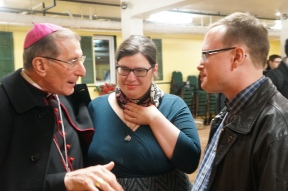 The Papal Nuncio talking with Rebecca and Michael Trolly, our organist and cantor at Annunciation.